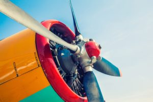 Orange Green and Red engine with propellers